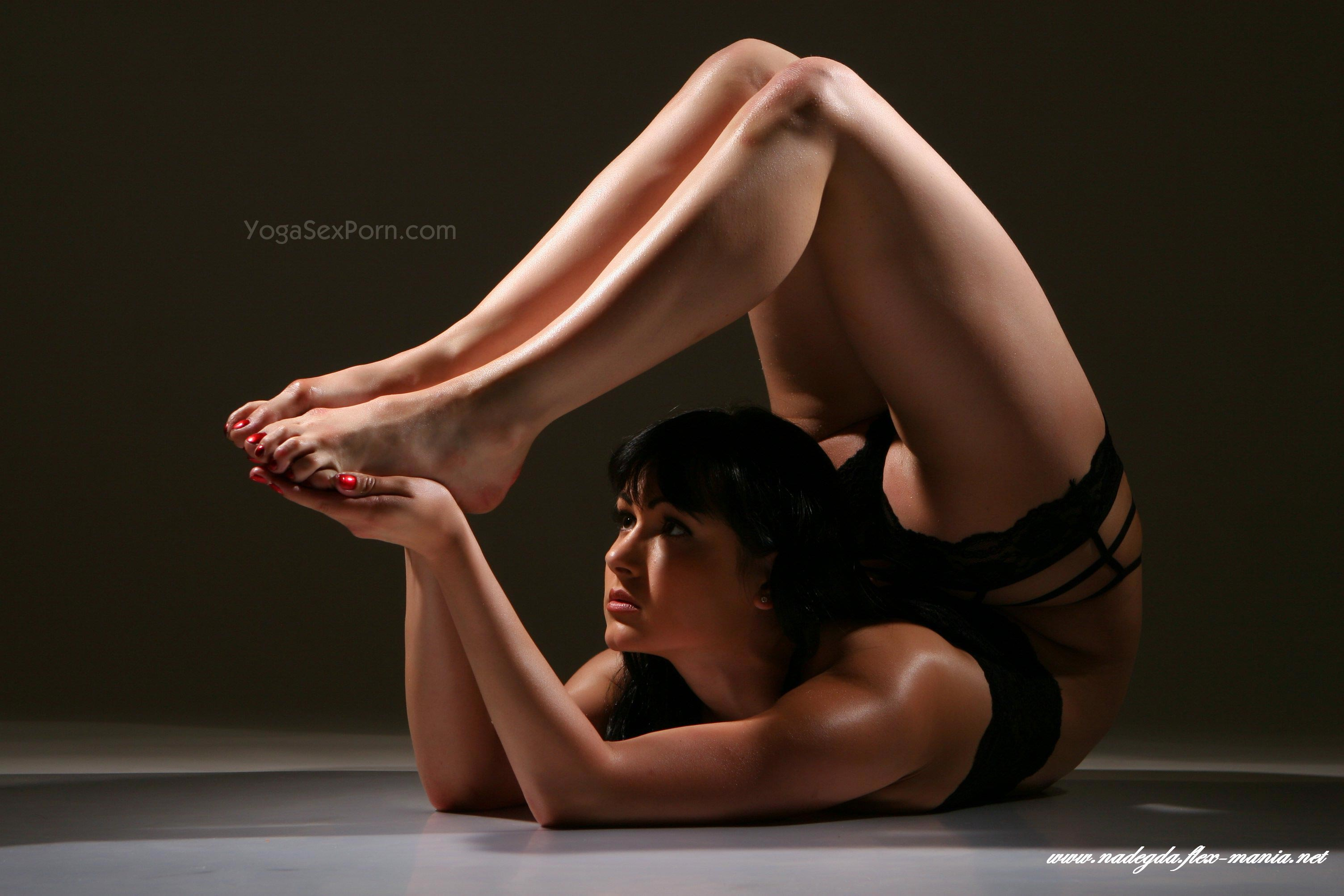 Sexy yoga girl Nadegda stands in different positions showing delights