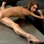 Nude yoga teacher bends backwards and does the splits